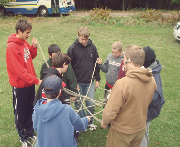 Kids Solving Rope Puzzle